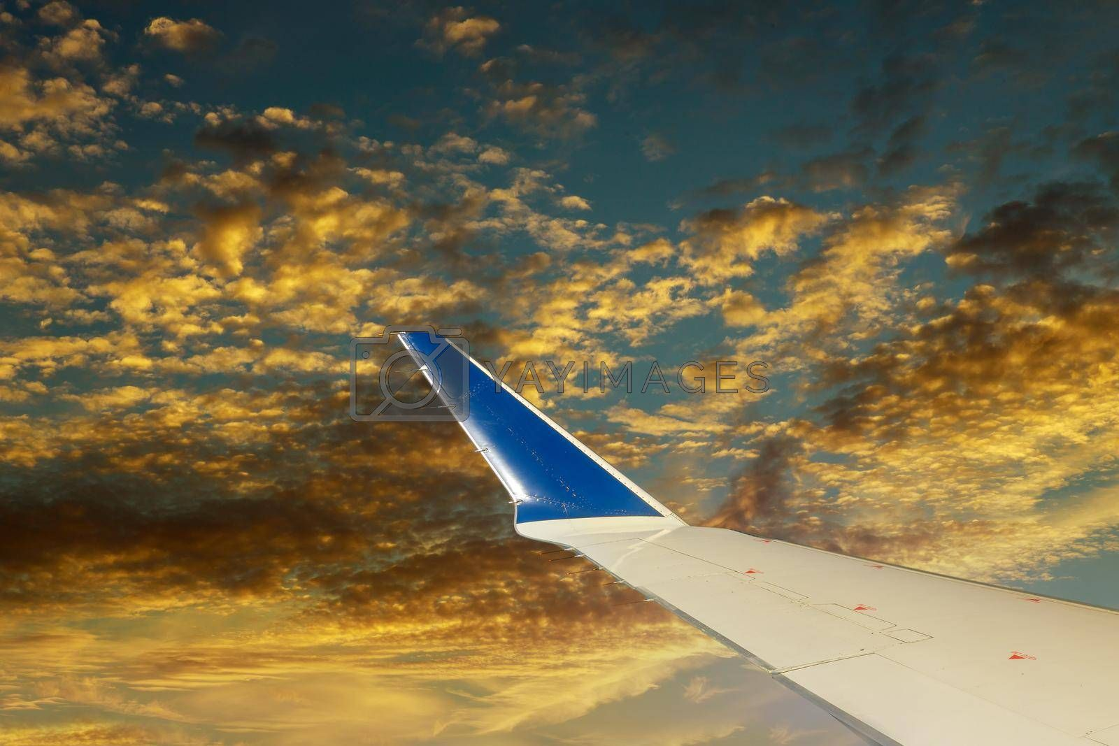 Clouds in the sky as seen evening majestic sunset a wing of an airplane flying