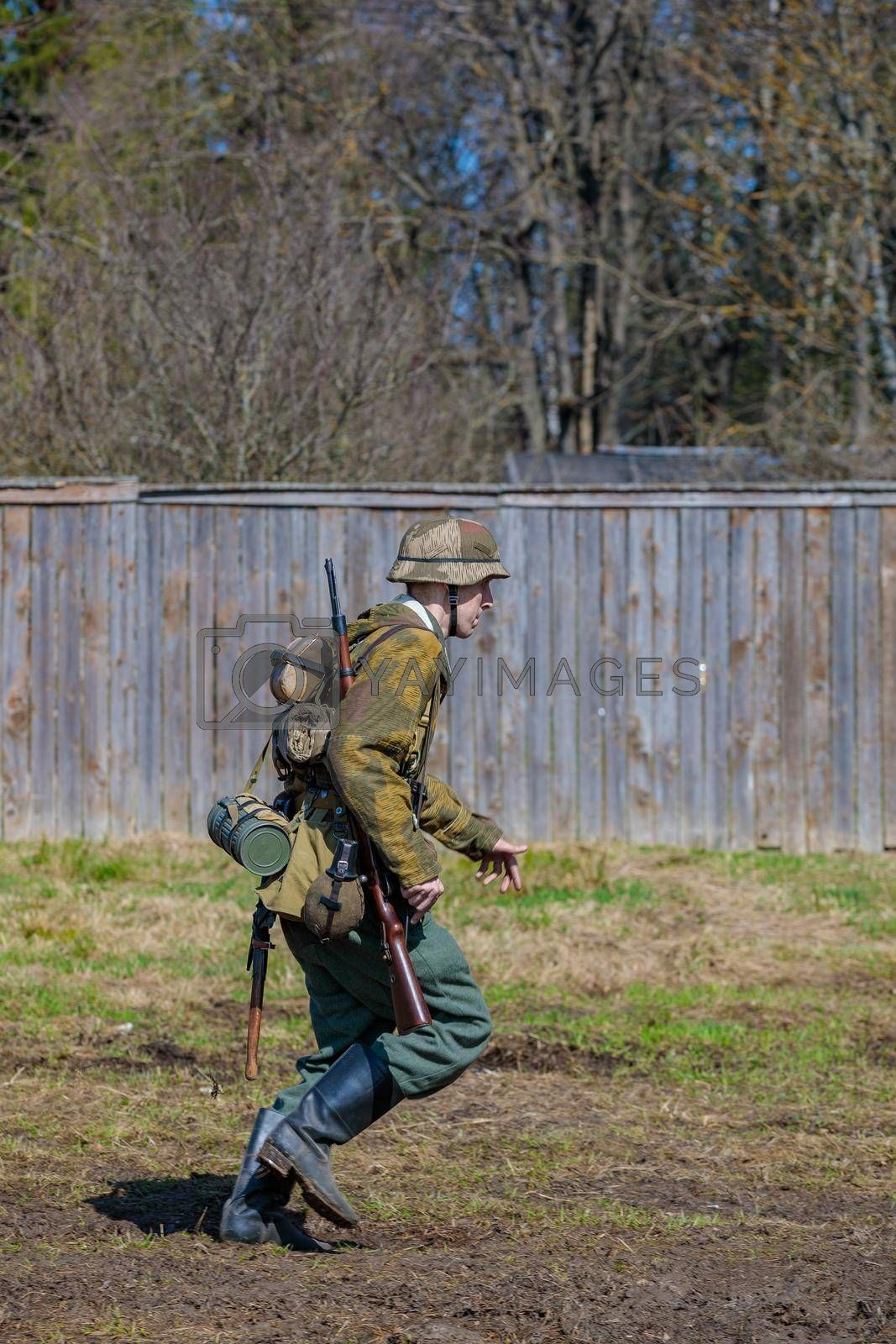 Reconstruction of the Second World War. A German soldier is running. The Great Patriotic War. Liberation of Odessa. Zelenograd Russia April 18, 2021