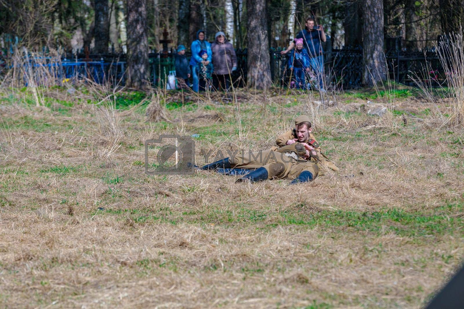 Reconstruction of the Second World War. Wounded soldiers lie on the battlefield. The Great Patriotic War. Liberation of Odessa. Zelenograd Russia April 18, 2021