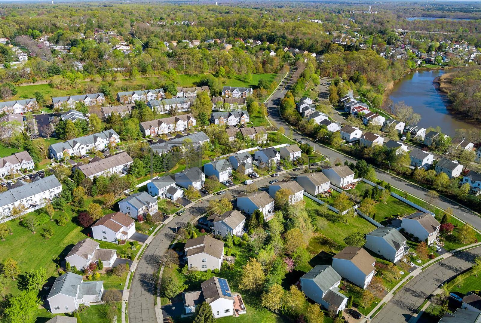 Aerial view of small american town residential houses neighborhood complex at suburban housing development
