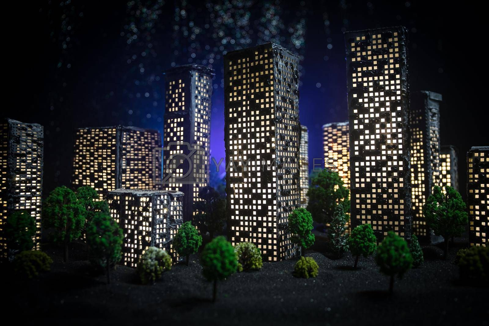 Cartoon style city buildings. Realistic city building miniatures with lights. background. Decorative city. Selective focus