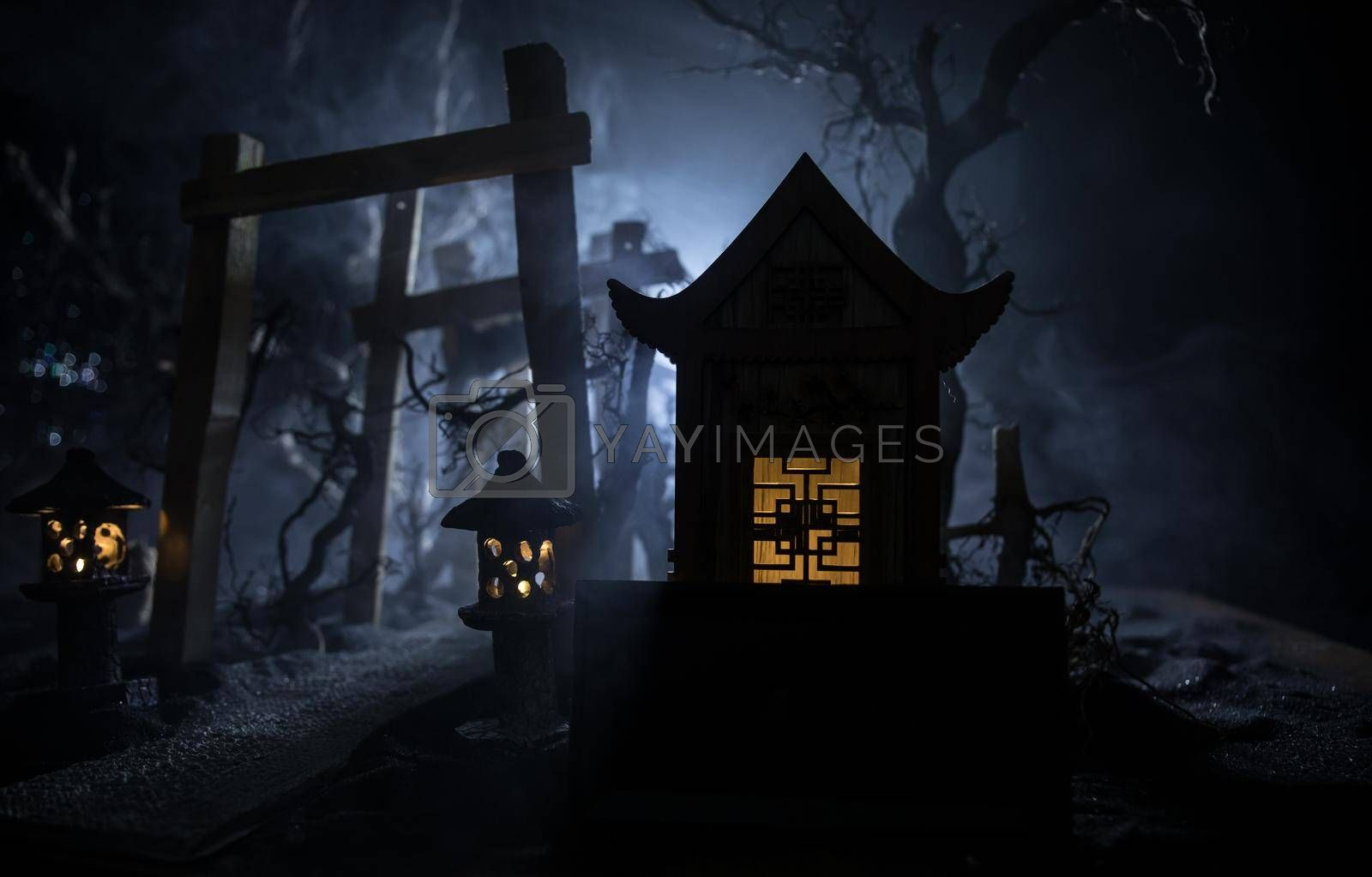 Creative artwork decoration. Abstract Japanese style wooden tunnel at night. Night scene in fantasy forest. Selective focus