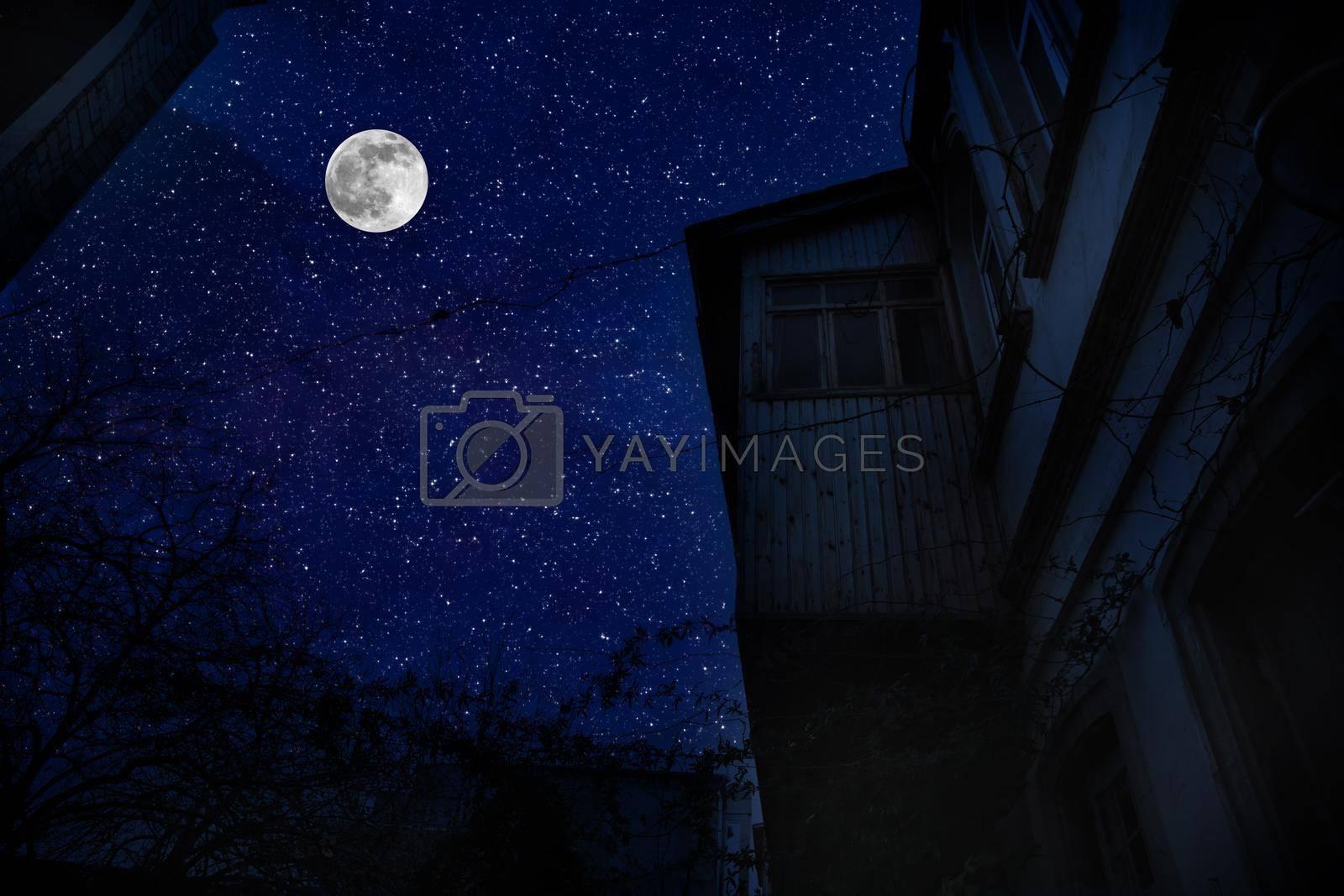 Old city streets at night. Full moon over the city at night, Baku Azerbaijan. Big full moon shining bright over buildings