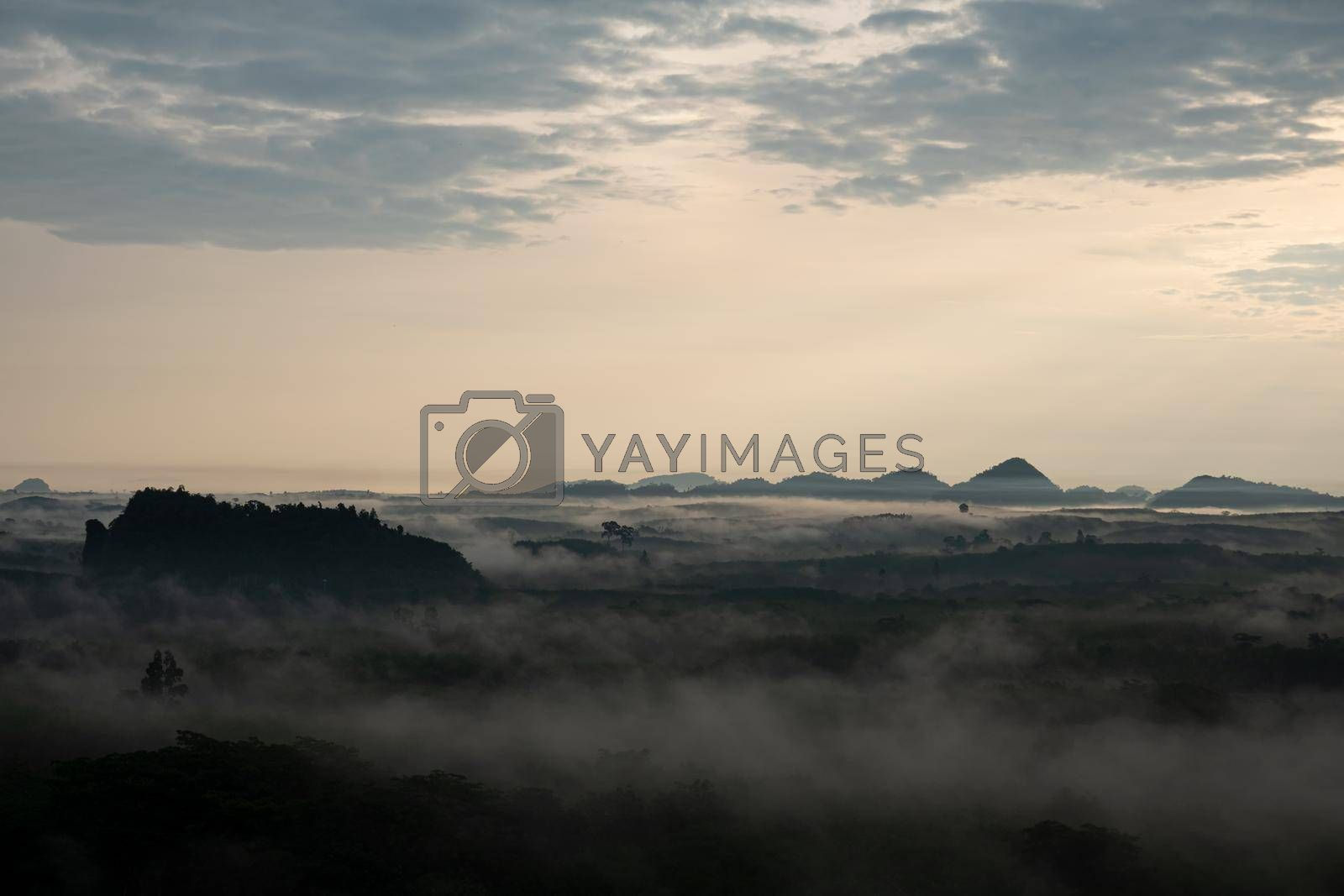 Royalty free image of misty morning sunrise, Landscape view of Khao Na Nai Luang temple on peak mountain at Surat Thani Province, Southern of Thailand by chuanchai