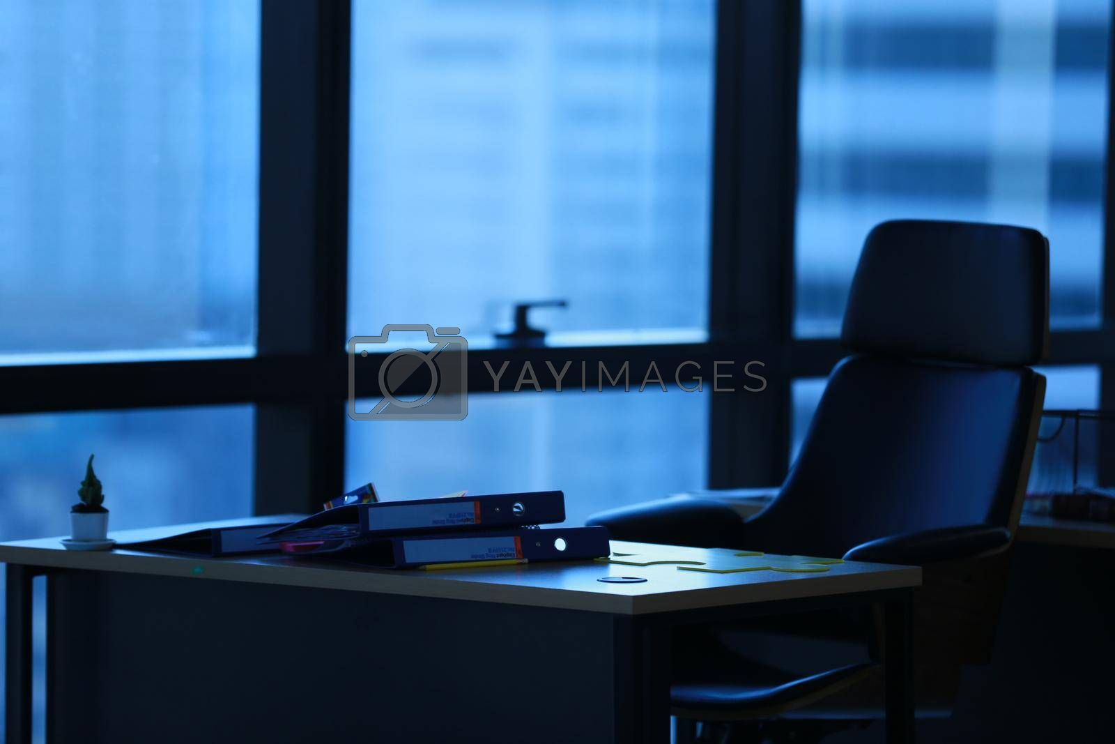 Royalty free image of office interior with a table and chairs by chuanchai