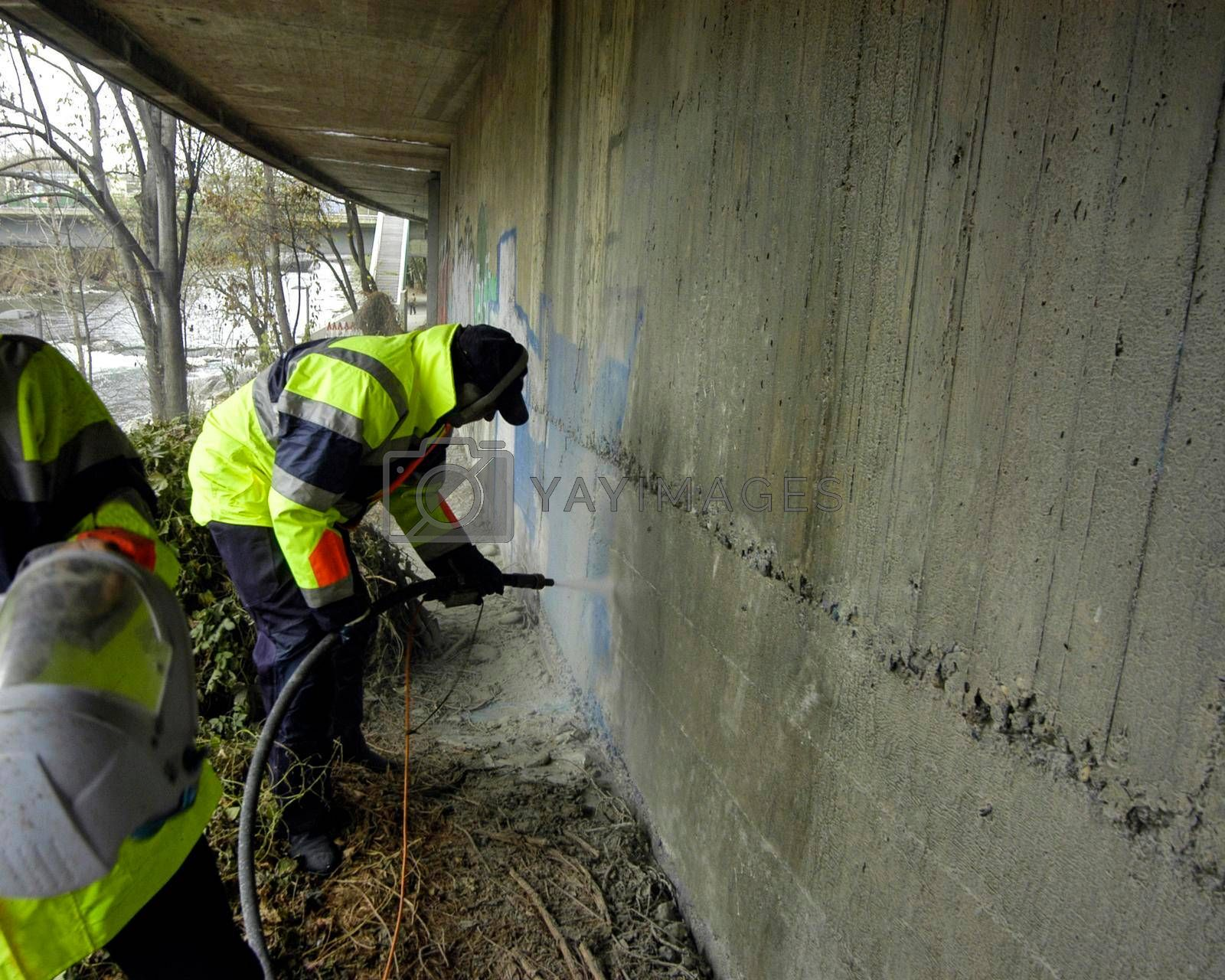 professional graffiti removal on a wall in a public space