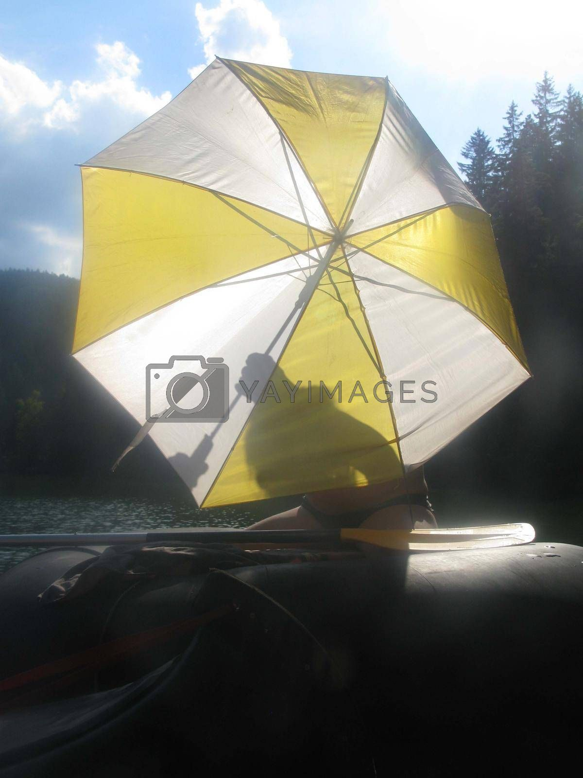 a sunshade or parasol in summer as a sun protection