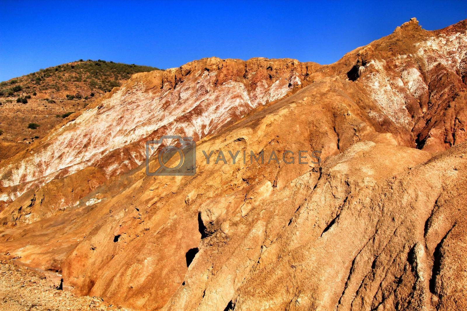 Beautiful and colorful mineral streaks and sediments in a old abandoned quarry