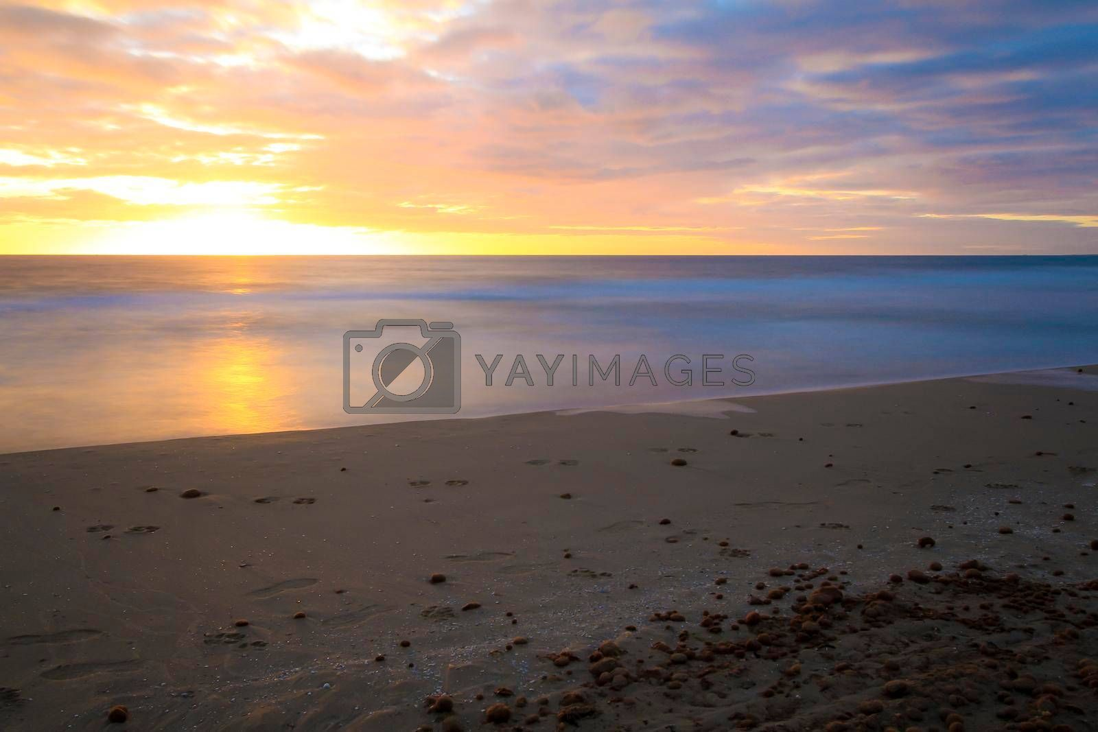 Beautiful Sunrise on the beach with pink and orange colors in Arenales del Sol, Alicante,southern Spain
