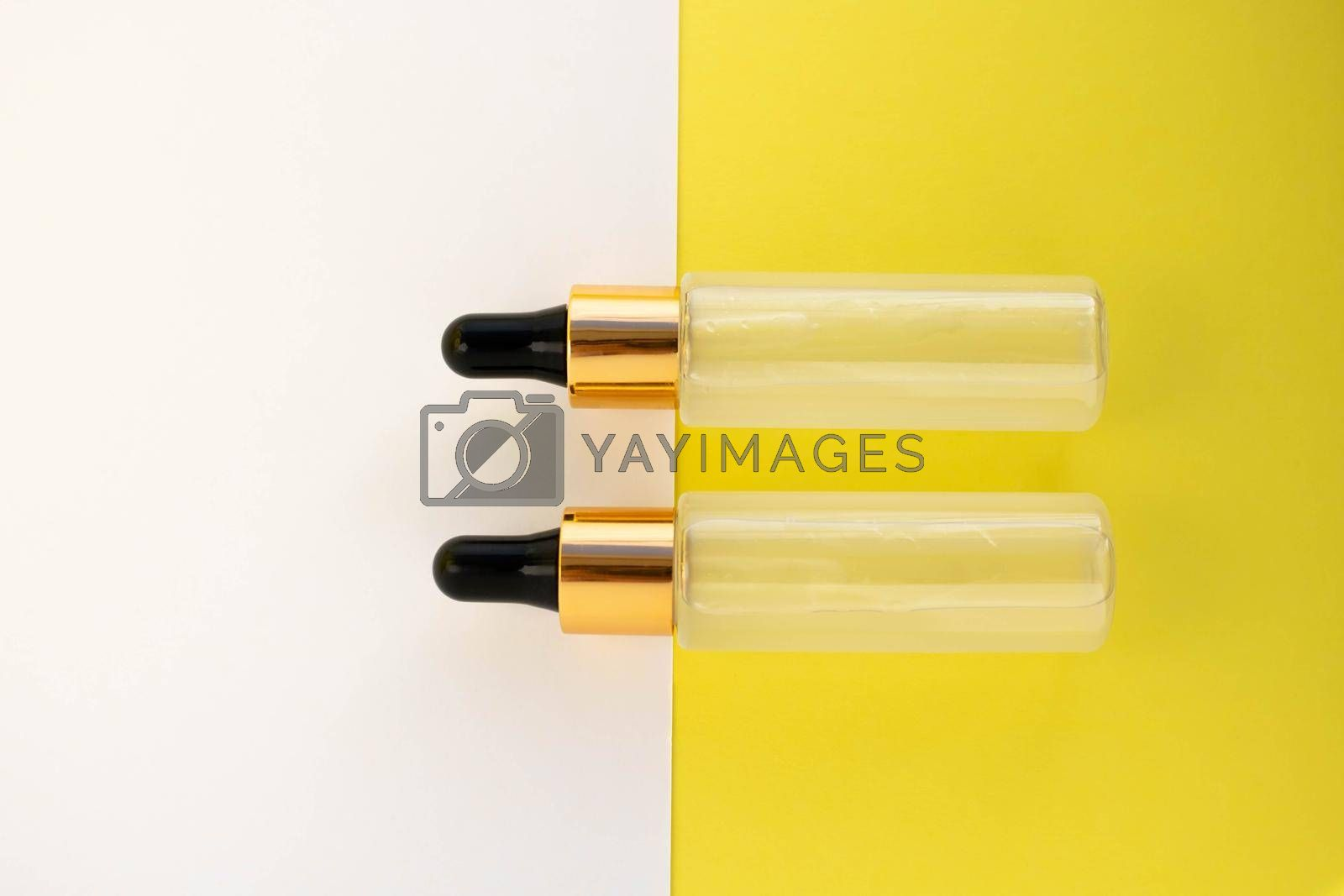 Two bottles of cosmetic liquid transparent gel on a white yellow background. Flat styling style.