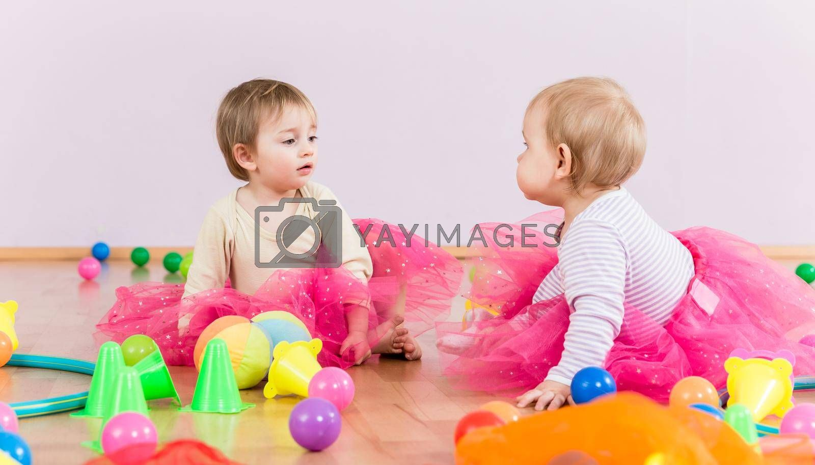 Royalty free image of Two toddlers playing together by Kzenon