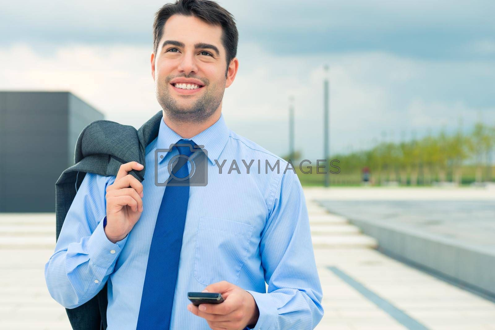 Handsome businessman or manager using phone in leisure time going home or on business travel