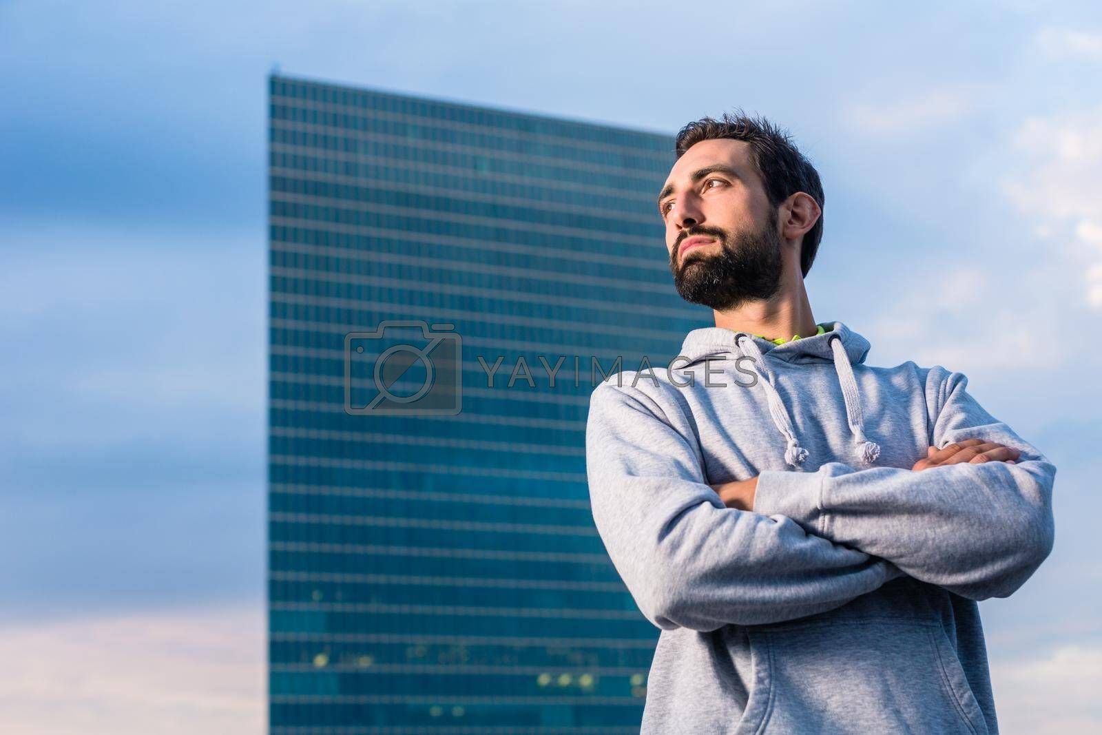 Royalty free image of Man doing sport for fitness in city by Kzenon