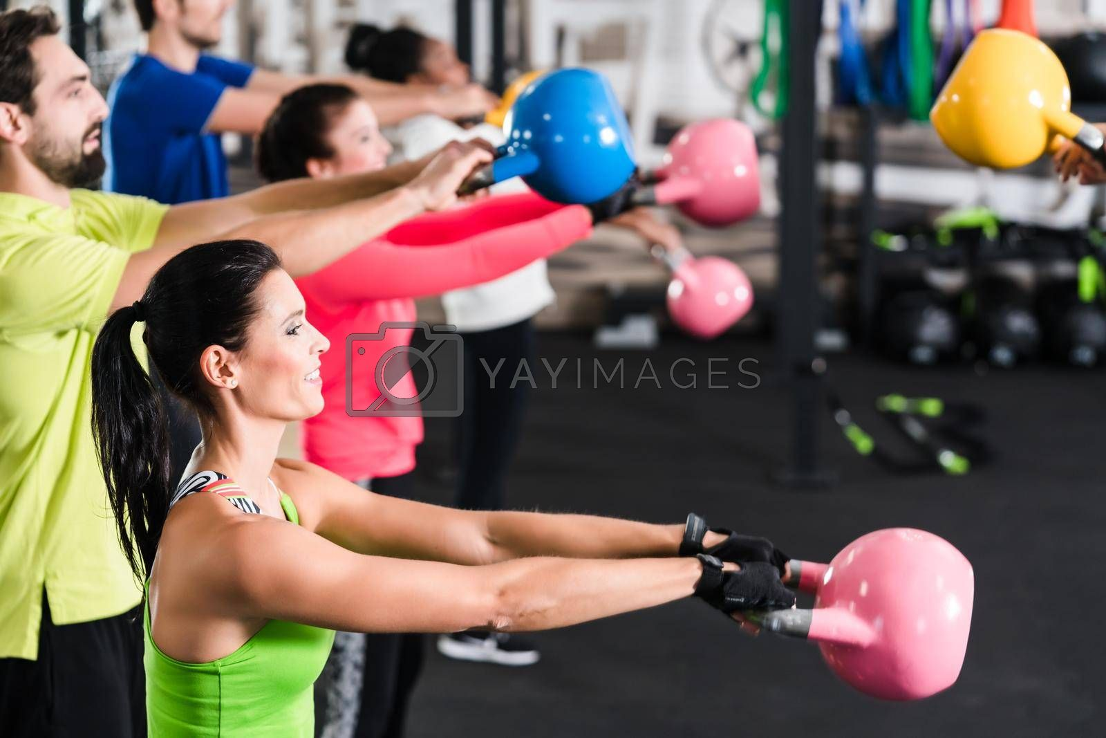 Royalty free image of Functional fitness workout in sport gym by Kzenon