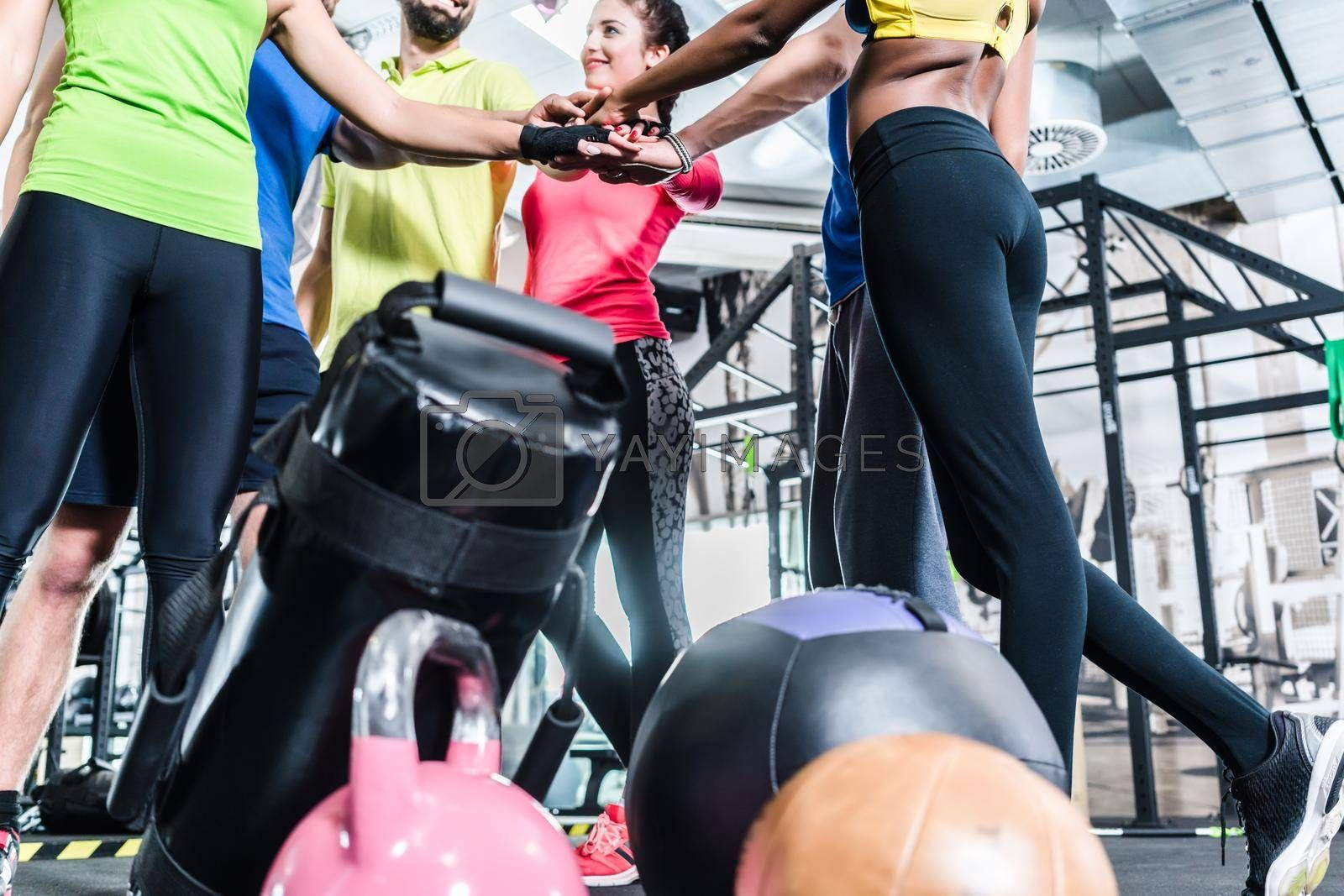 Royalty free image of Woman and men being motivated for fitness and sport by Kzenon