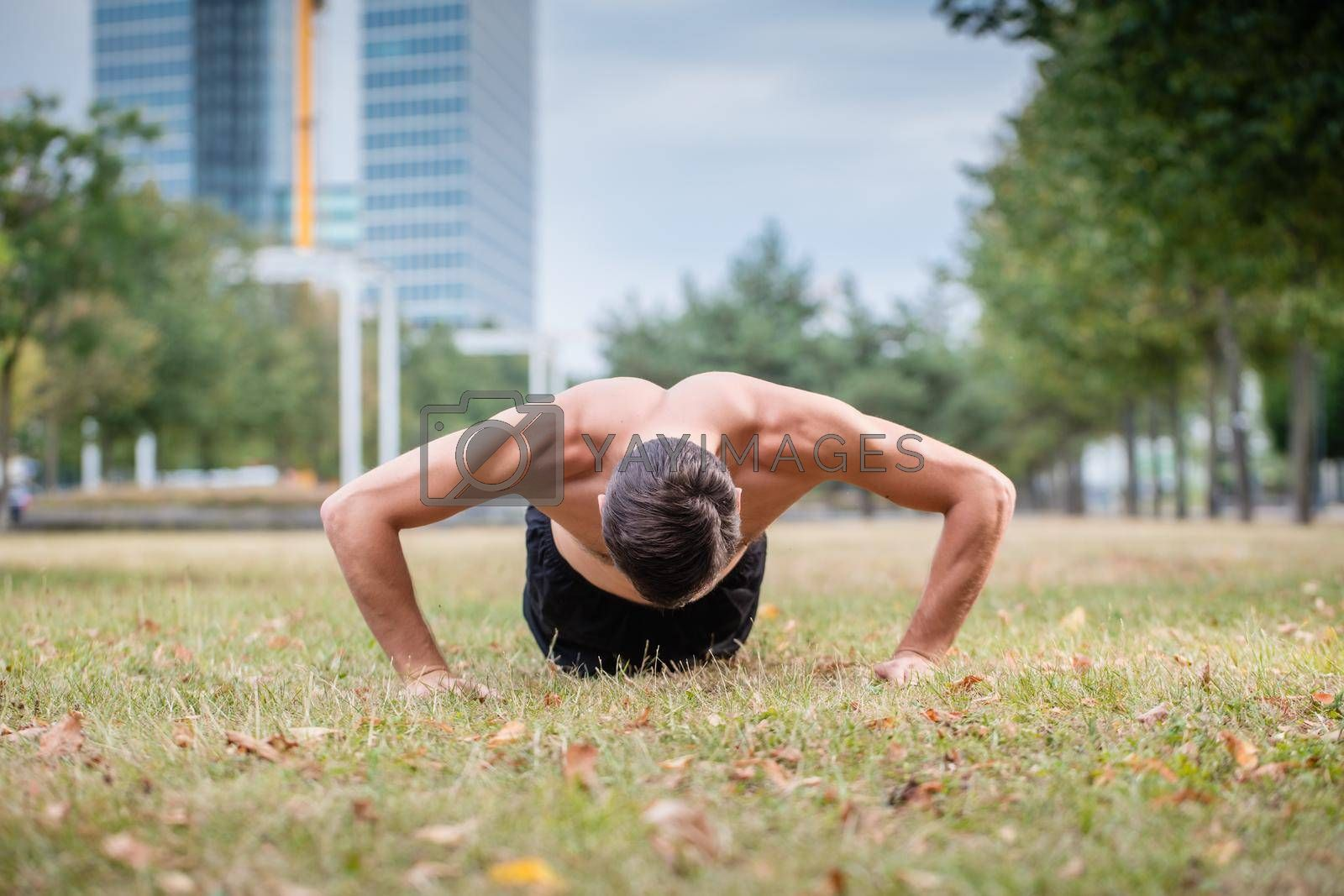 Royalty free image of Man doing push-up as sport for better fitness by Kzenon