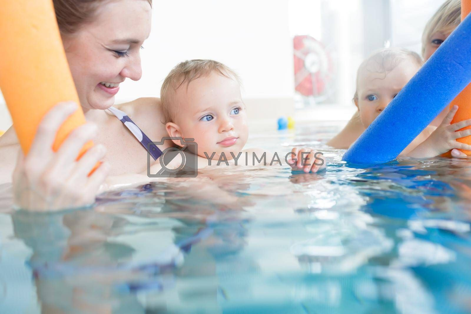 Royalty free image of Mothers being happy about their babies playing with each other i by Kzenon