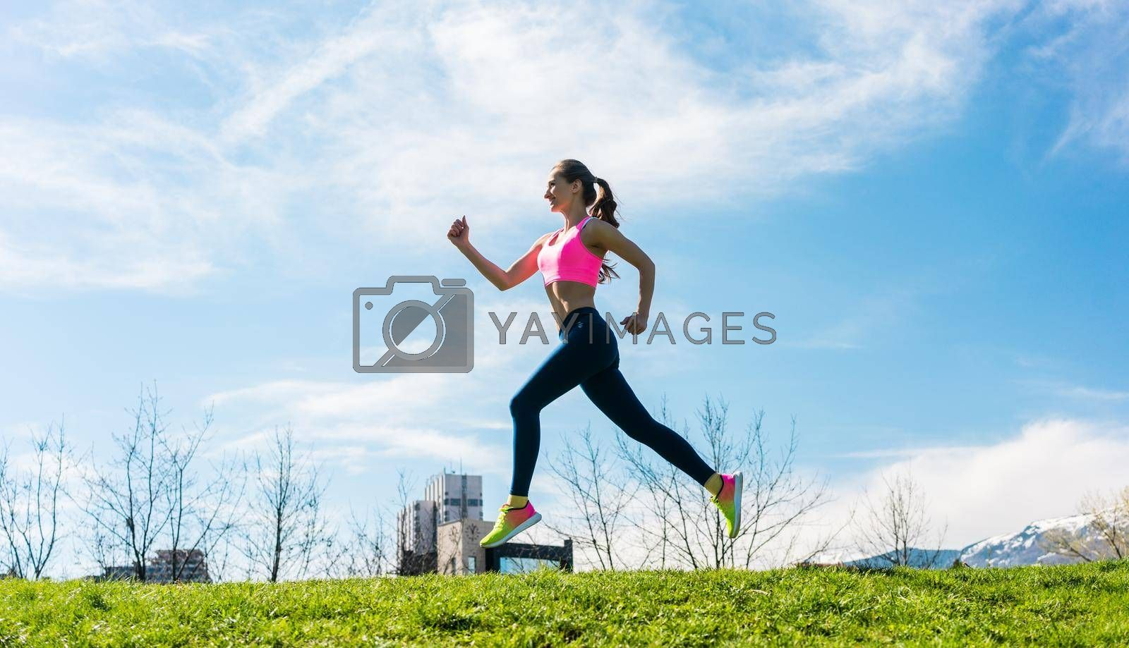 Royalty free image of Woman sport running on hill for fitness by Kzenon
