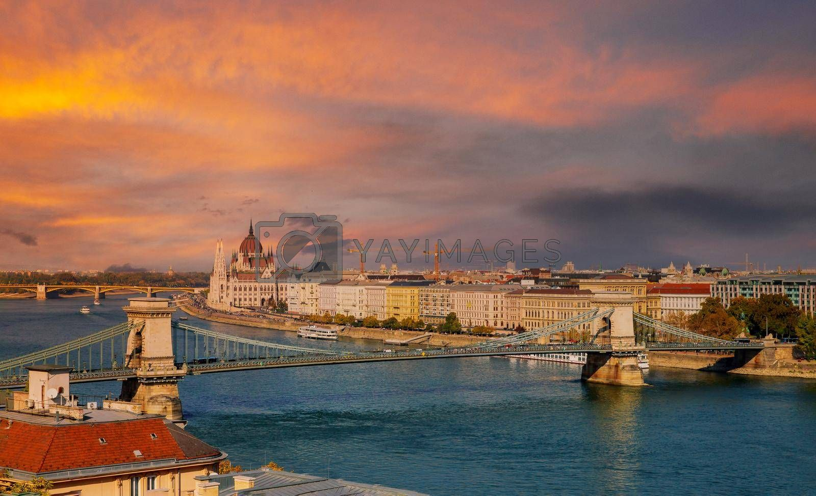 Panoramic sunset view with Chain bridge on river Danube in Budapest parliament building capital of Hungary