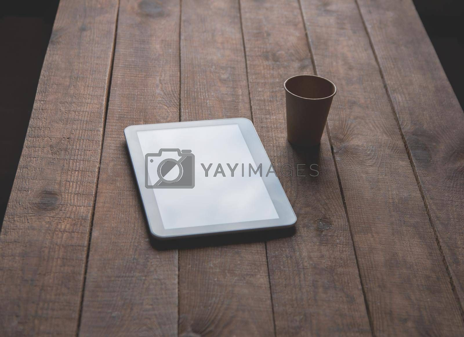 Office workplace with tablet pc on the table.  For a design presentation or portfolio.