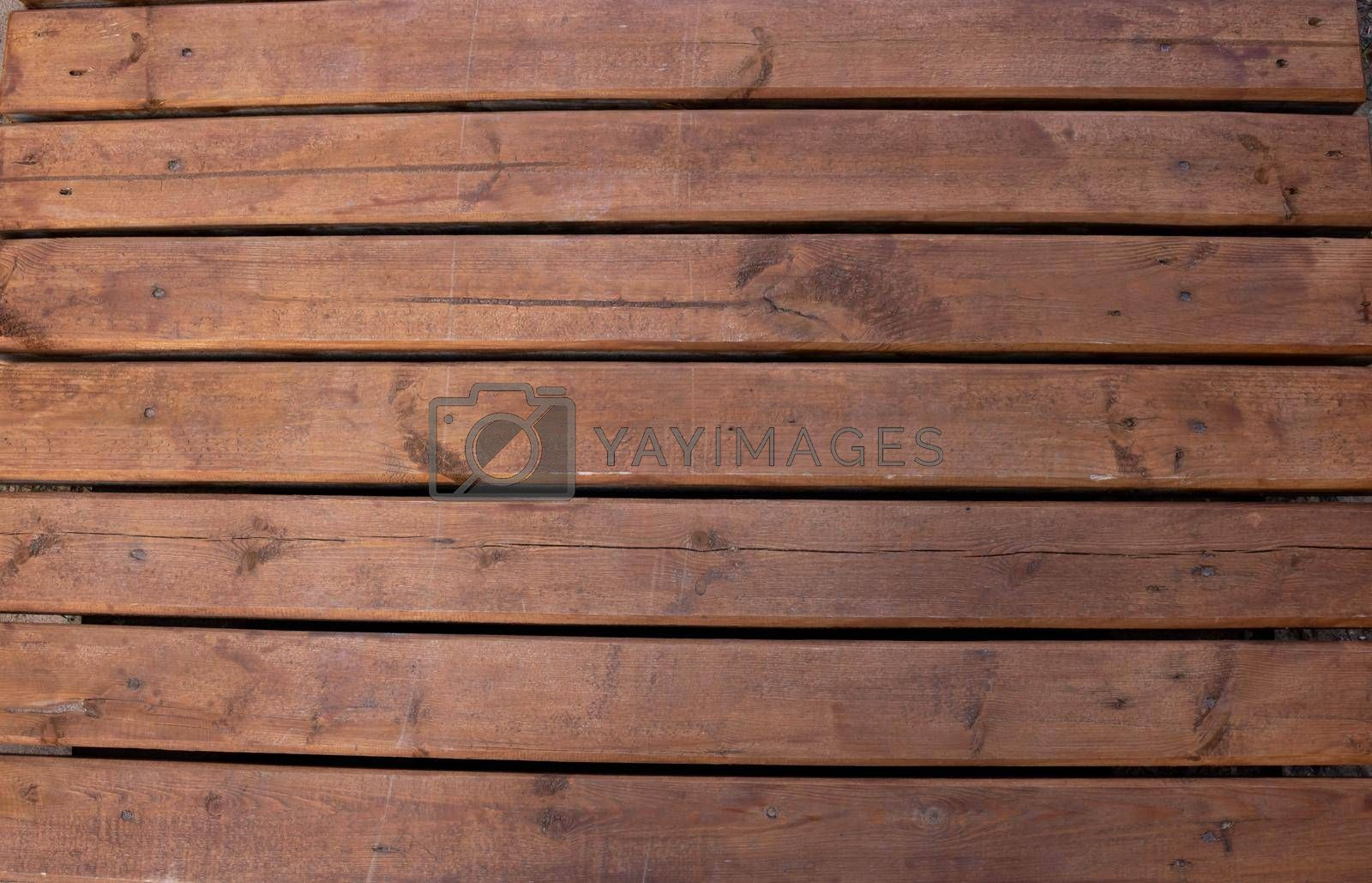 Brown wooden boardwalk.Beautiful rustic background.