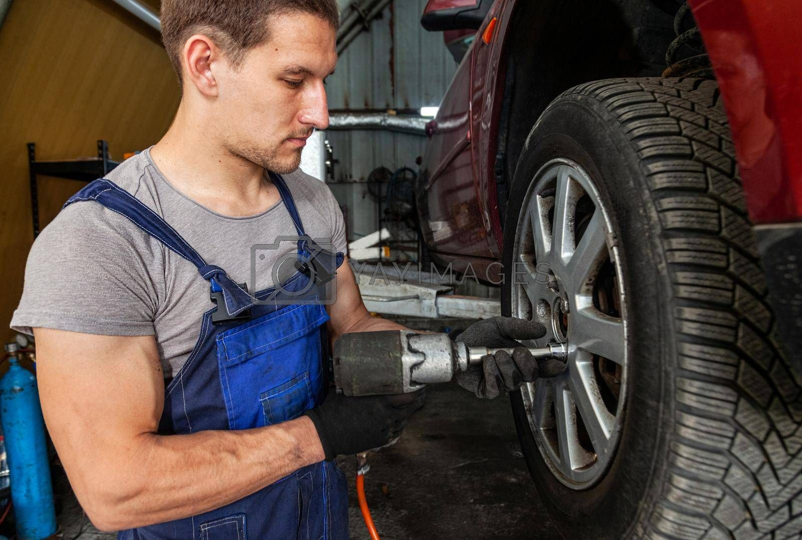 Royalty free image of Wheel Technician Repair Auto Service Mechanic Vehicle by vilevi