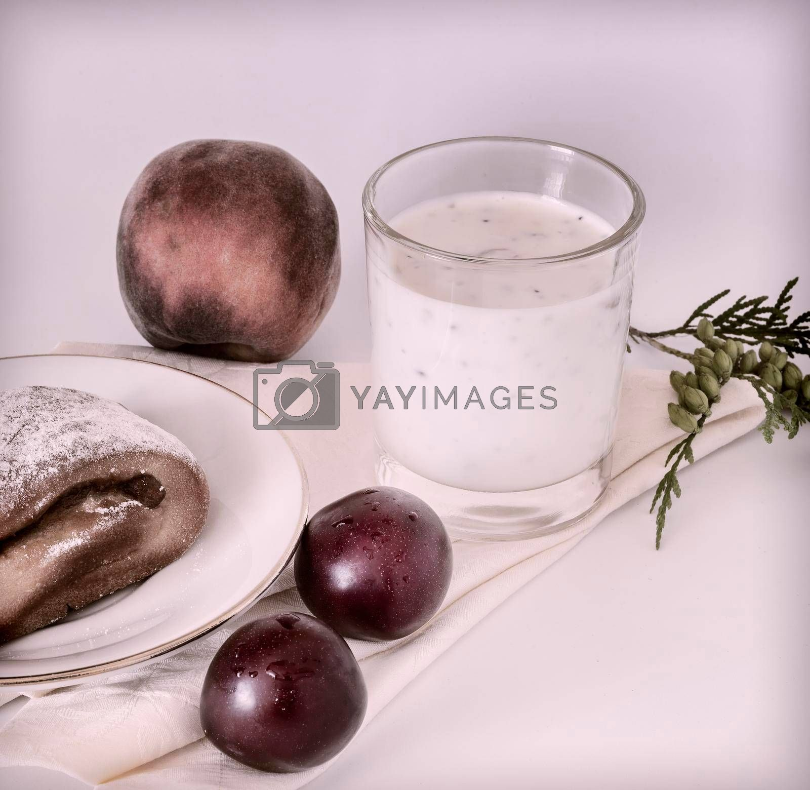 Royalty free image of Healthy Breakfast: yoghurt, delicious scones and plums by georgina198