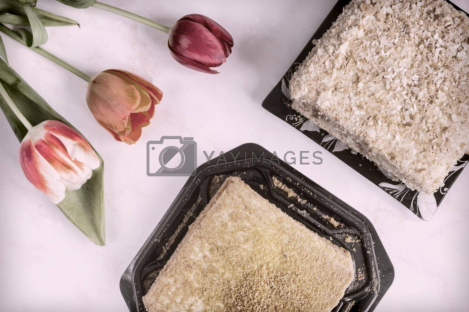 Royalty free image of Delicious cake and flowers on the table by georgina198