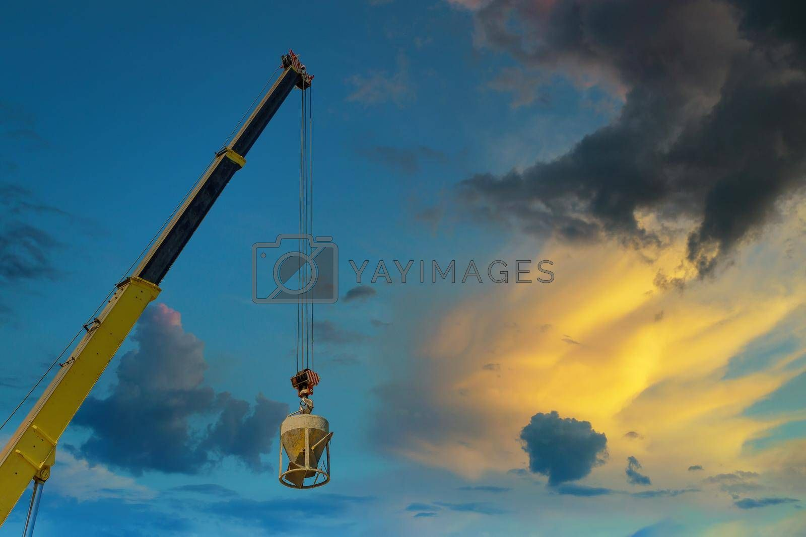 Working at height equipment with bucket liquid concrete container with hanging on crane hook in construction site building industry