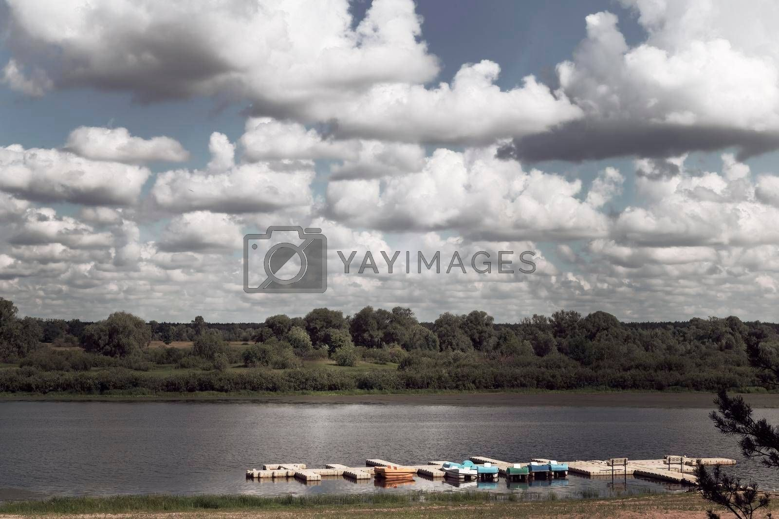 Royalty free image of Summer landscape: river and sandy beach on the shore. by georgina198