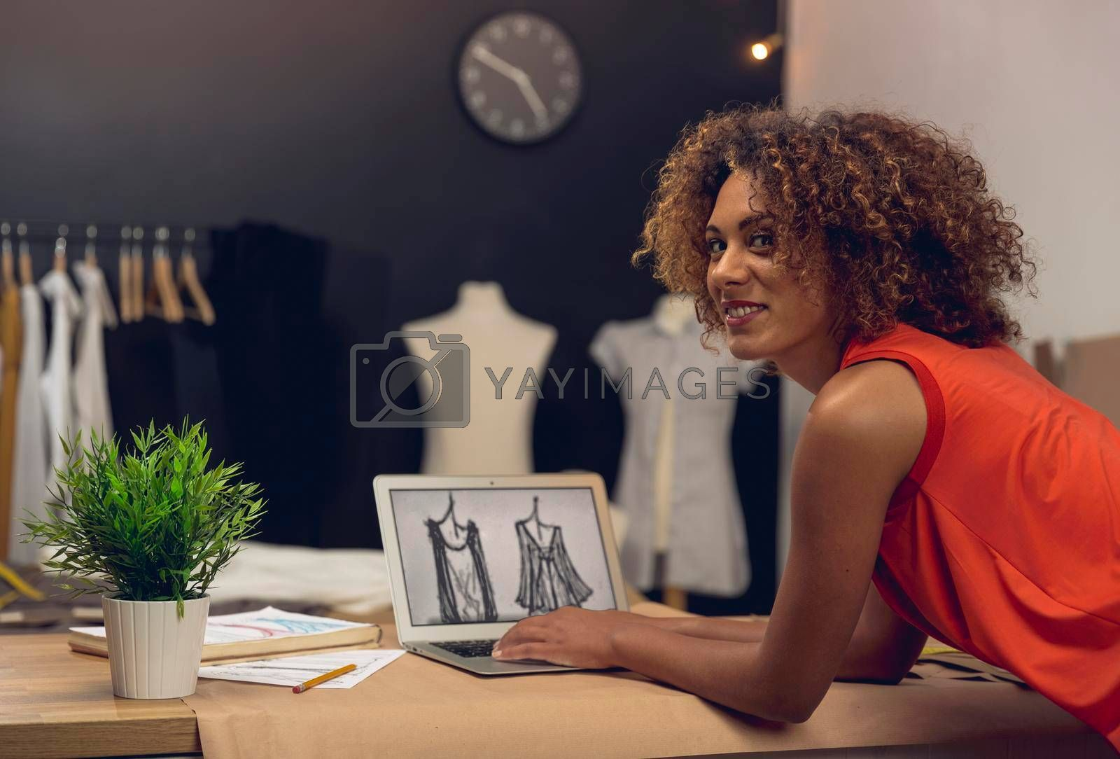 Royalty free image of Fashion designer on her Atelier by Iko