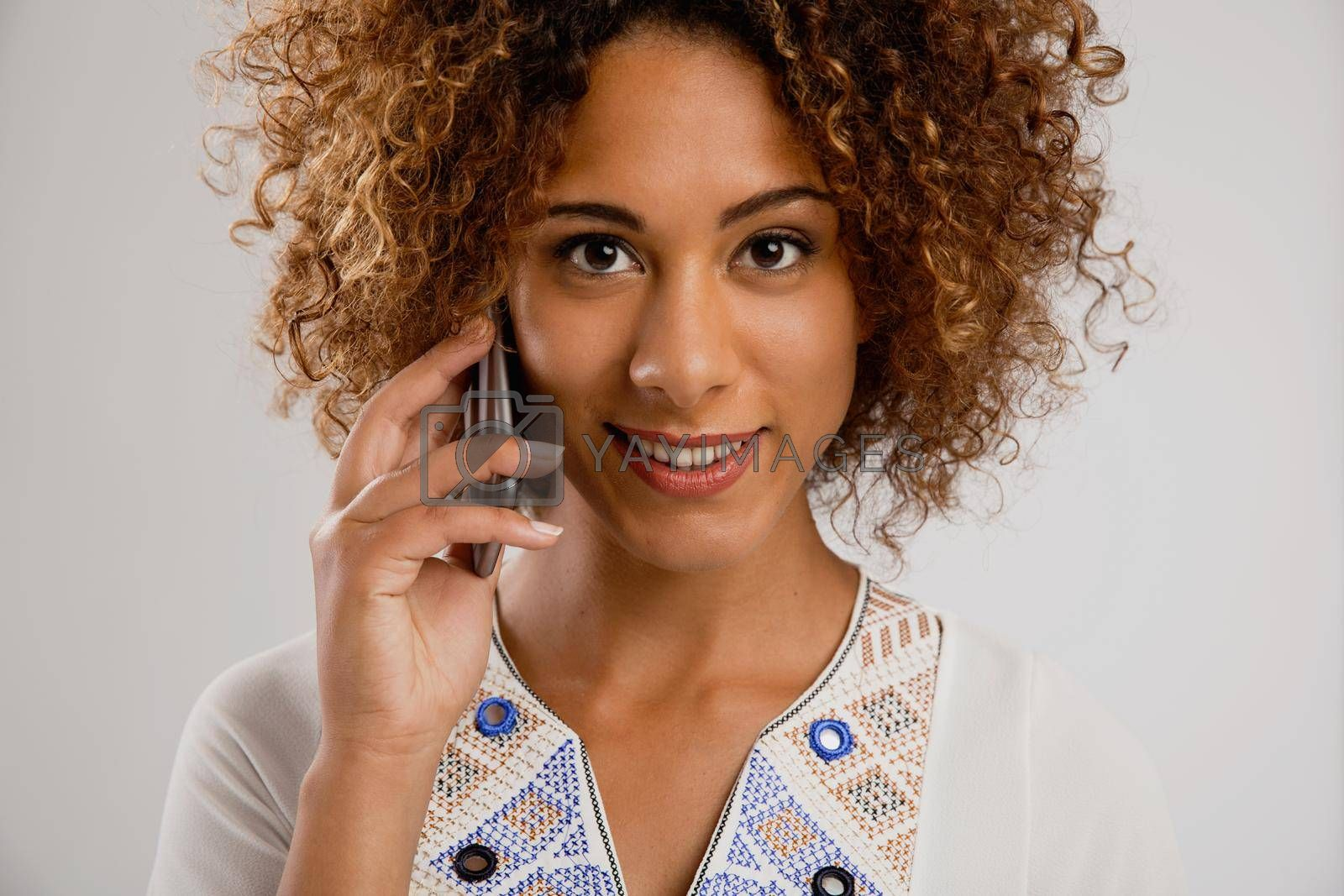 Royalty free image of Woman talking on the phone by Iko