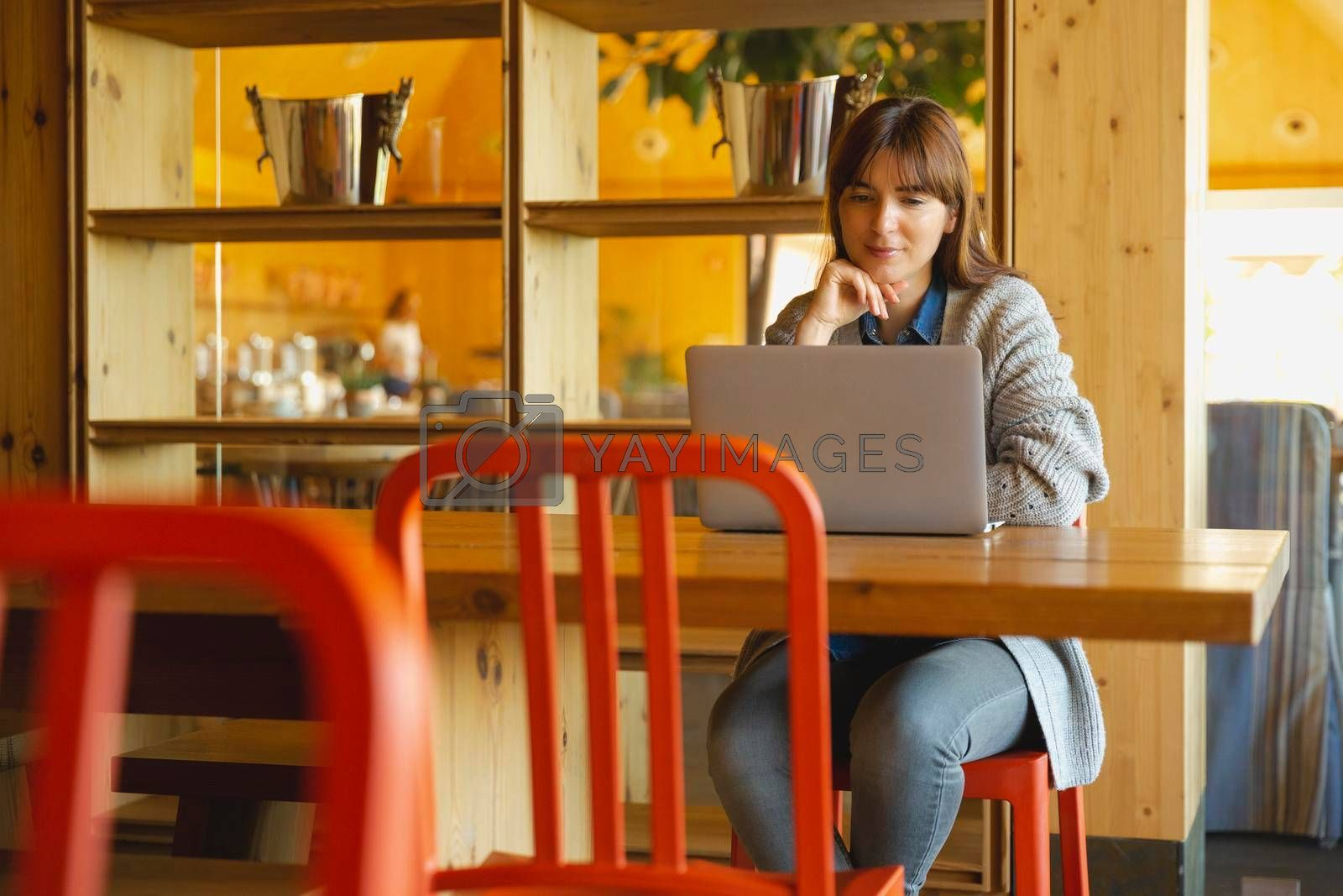 Royalty free image of Woman working on a laptop  by Iko