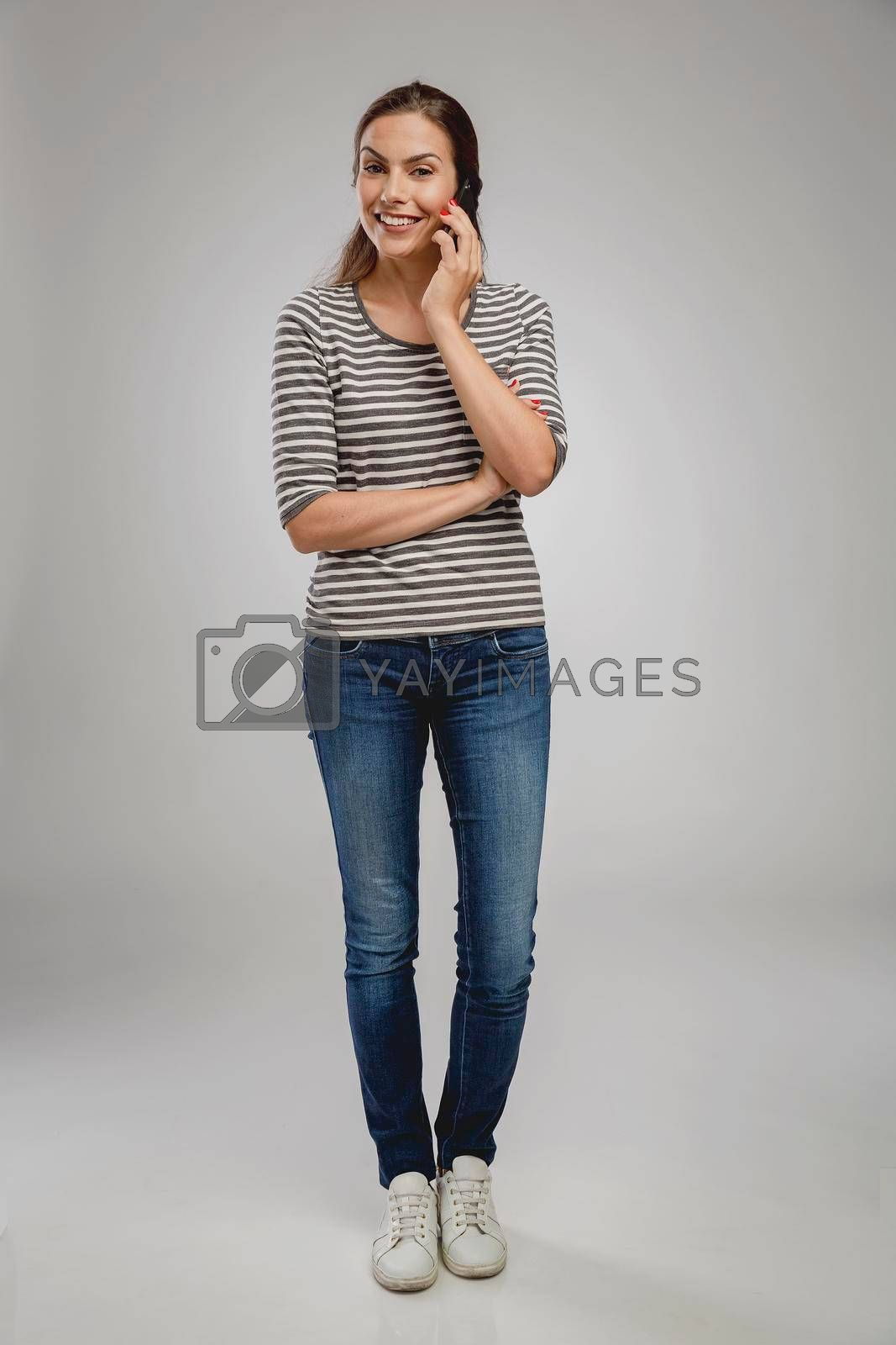 Royalty free image of Beautiful woman talking on phone by Iko