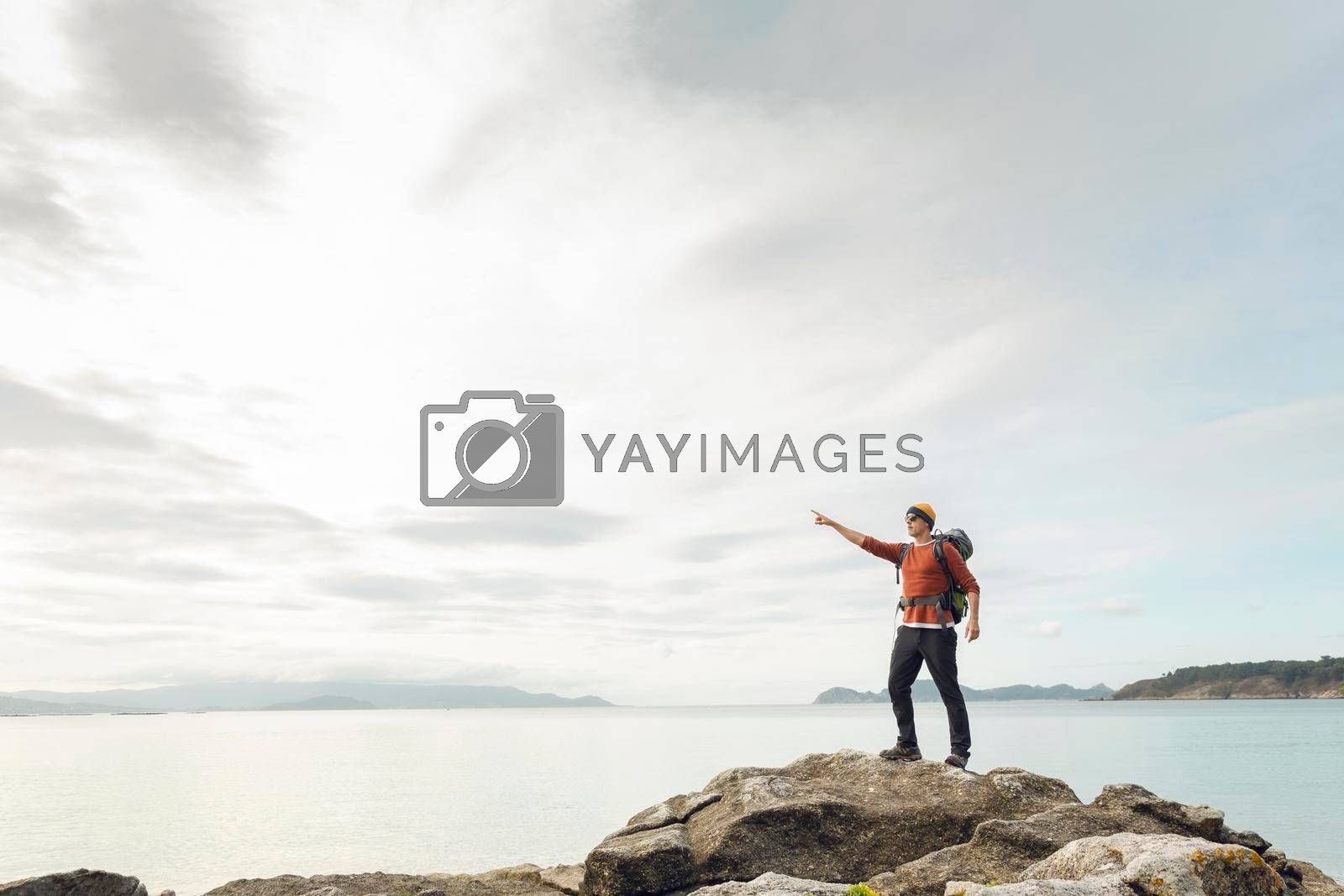 Royalty free image of Man pointing to the view by Iko