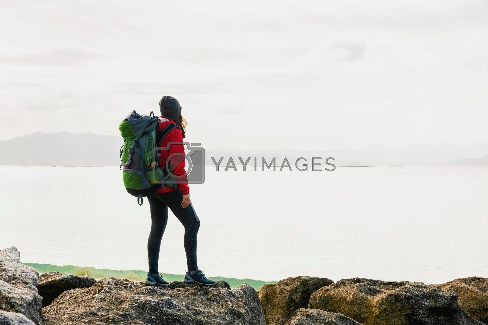 Royalty free image of Woman exploring the coast by Iko