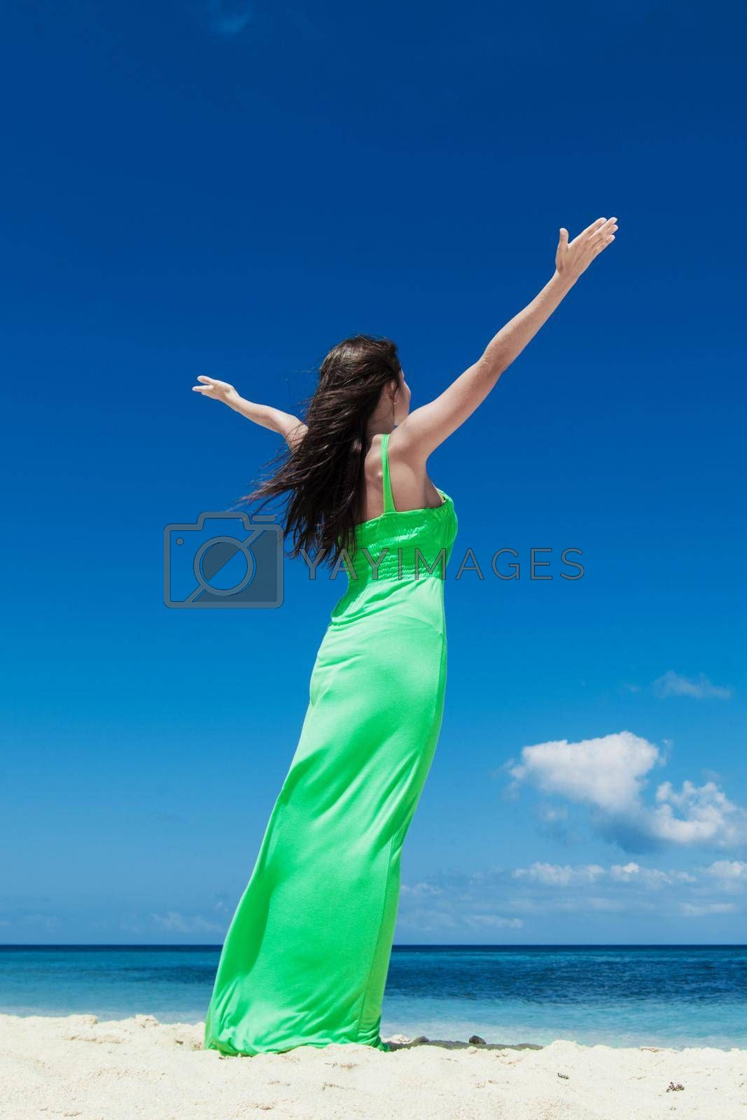Royalty free image of Happy woman enjoy vacation by Yellowj