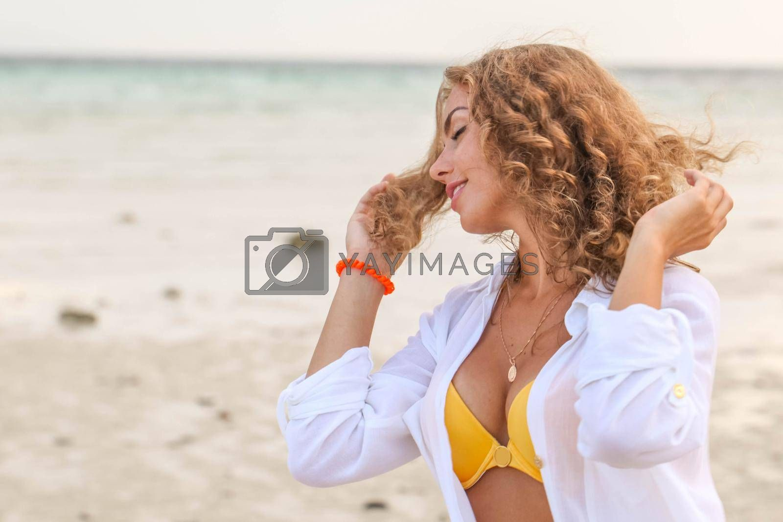 Royalty free image of Woman enjoy vacation on beach by Yellowj