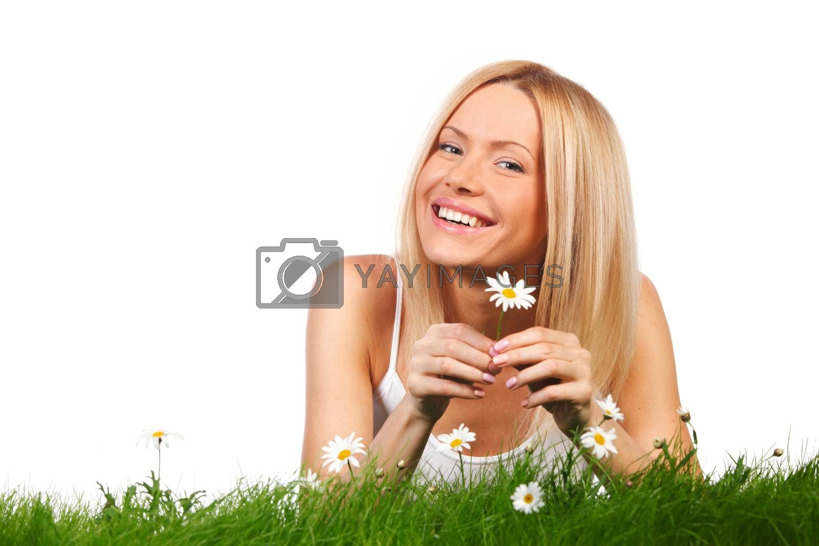 Royalty free image of Woman on grass with flowers by Yellowj