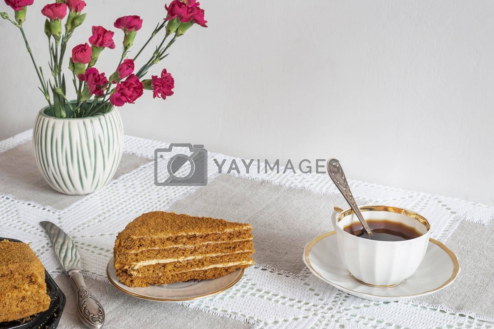 Royalty free image of A decaf hot chicory drink and a cake. by georgina198