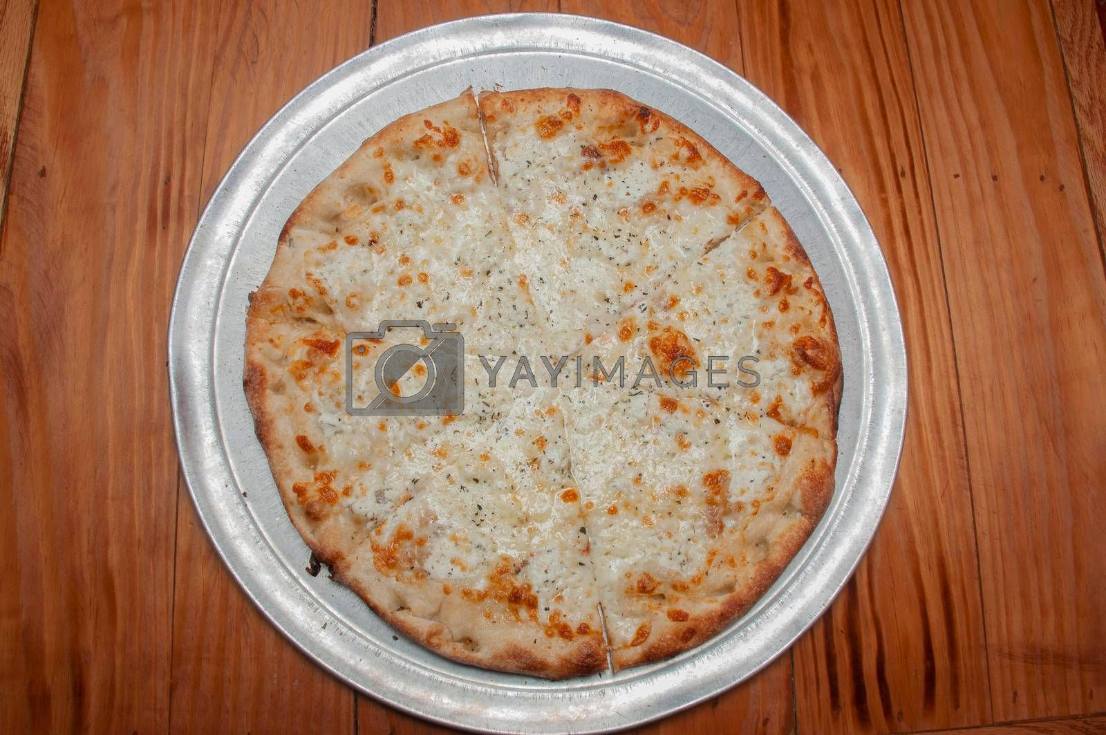 Delicious tomato sauce cheese covered hot and tasty white pizza pie
