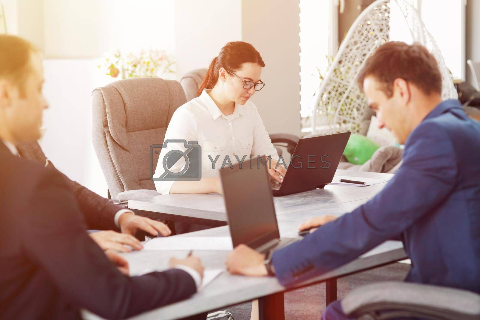 Royalty free image of Young attractive business woman working in the office, developing her strategy by selinsmo