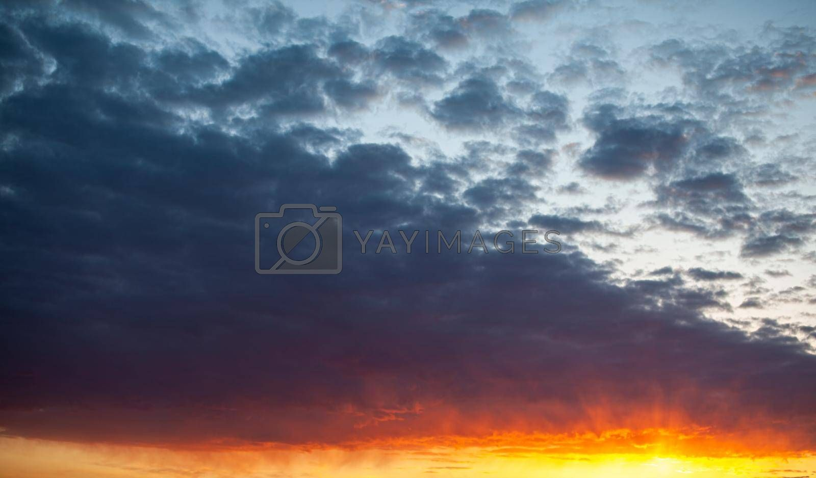 Colorful sunset or sunrise in the sky. The sky and clouds are painted in different delicate colors.