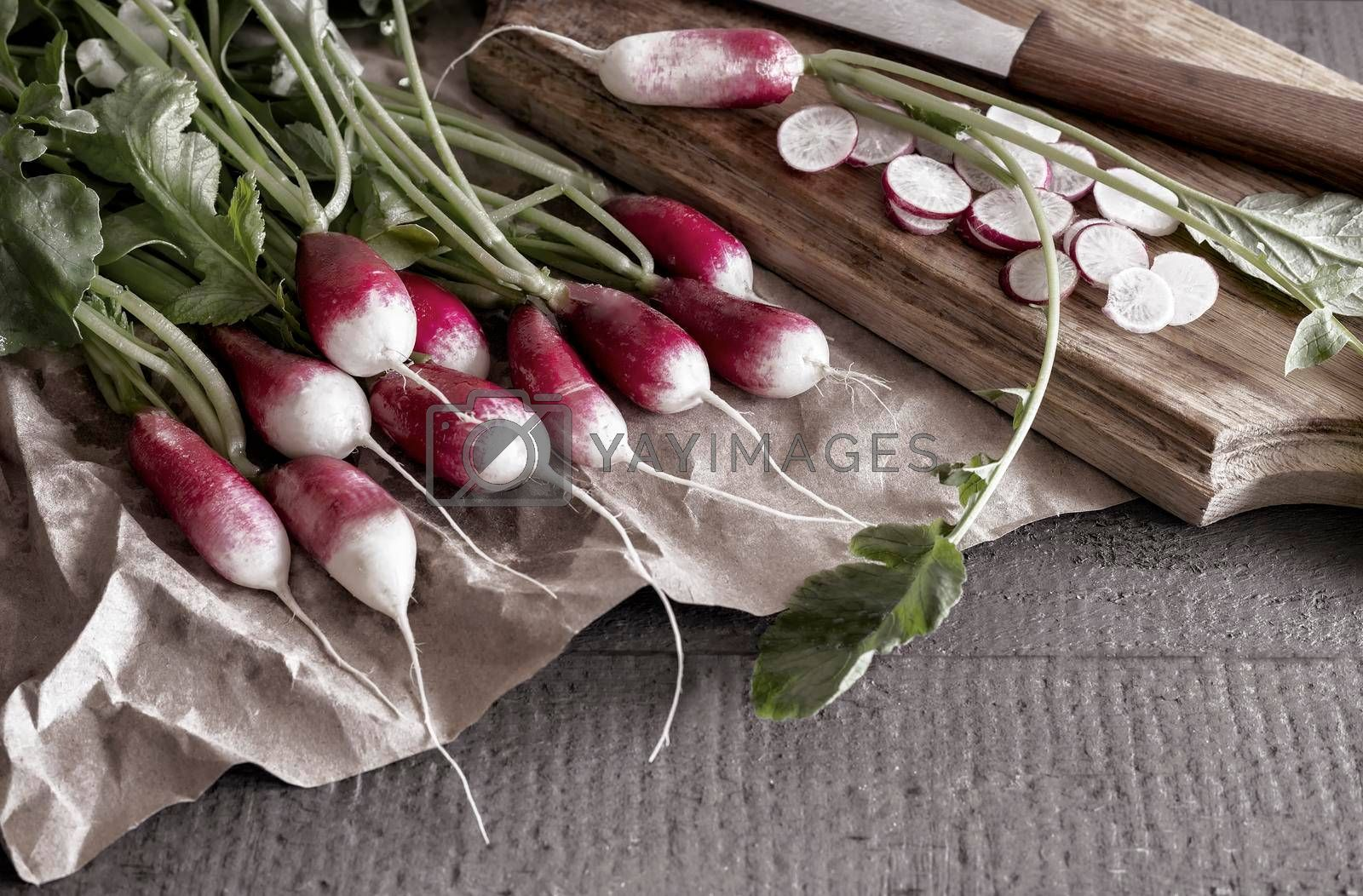 Royalty free image of Young radish with green leaves on the table. by georgina198