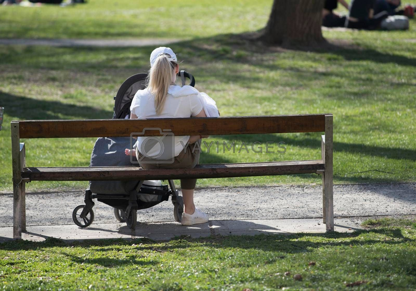 a mother with her child and baby stroller, maternity leave