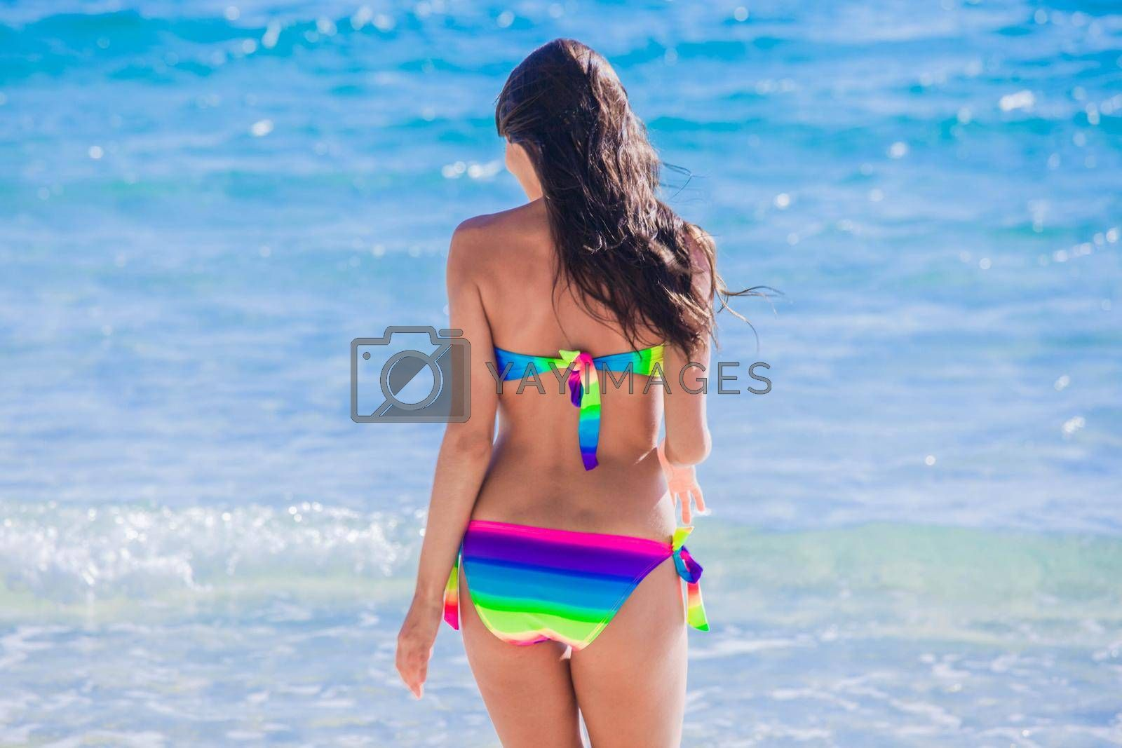 Royalty free image of Woman on sunny tropical beach by Yellowj