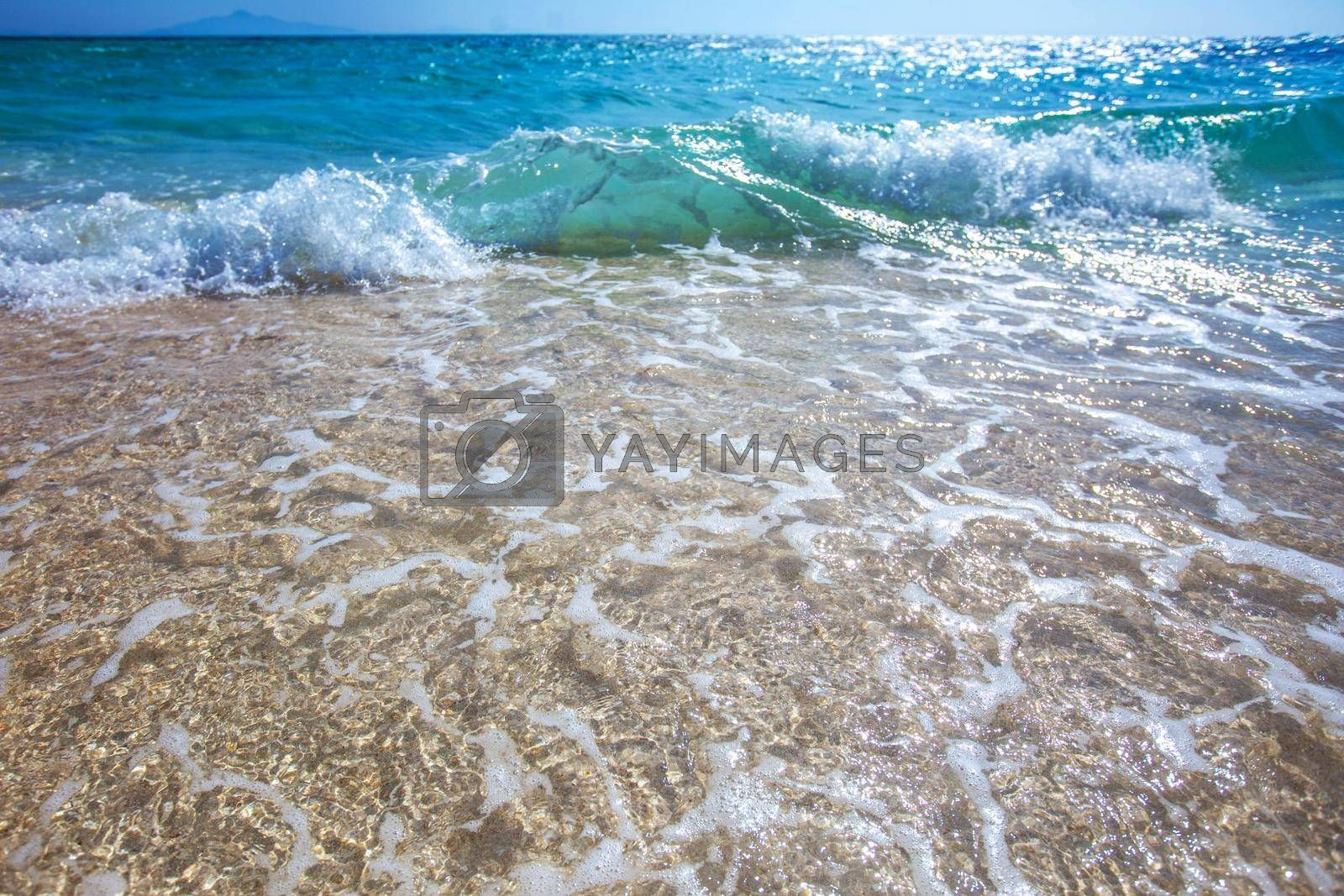 Royalty free image of Wave of the sea on the sand beach by Yellowj