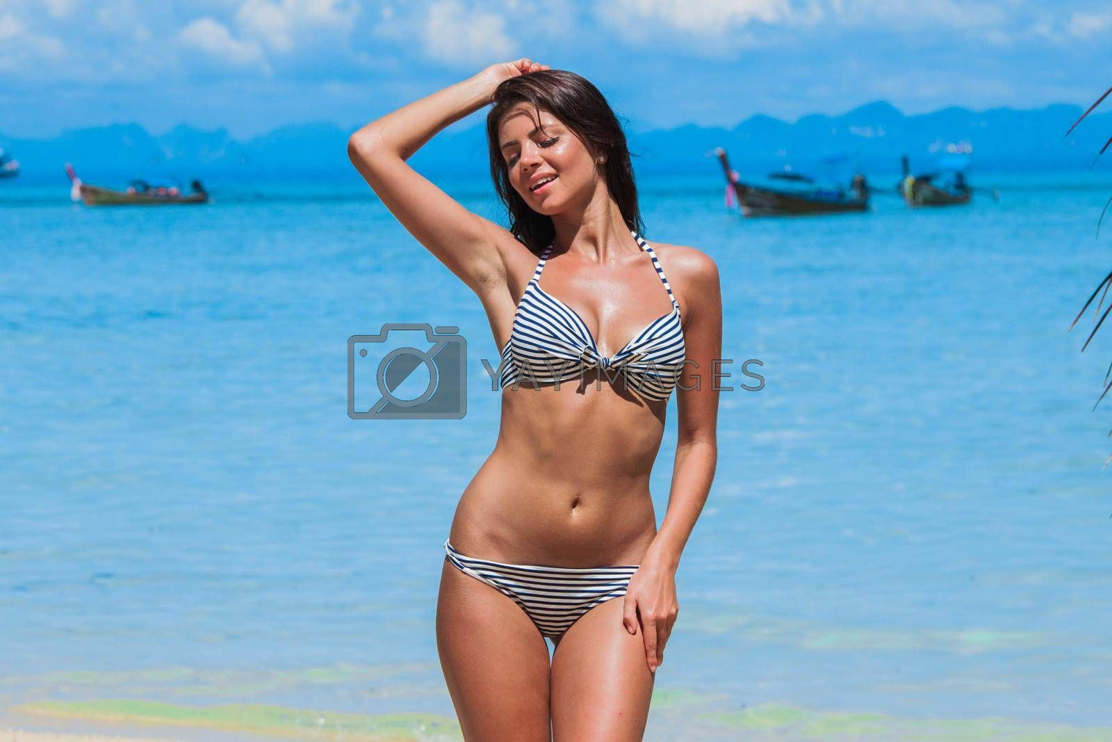 Royalty free image of Woman on tropical beach in Thailand by Yellowj