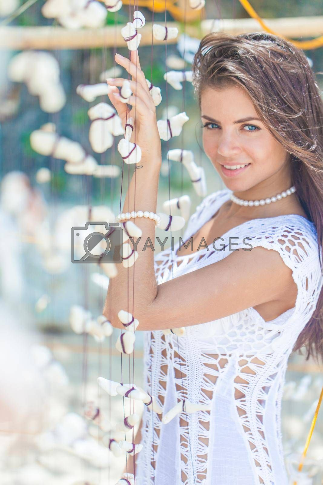 Royalty free image of Woman in white dress on vacation by Yellowj