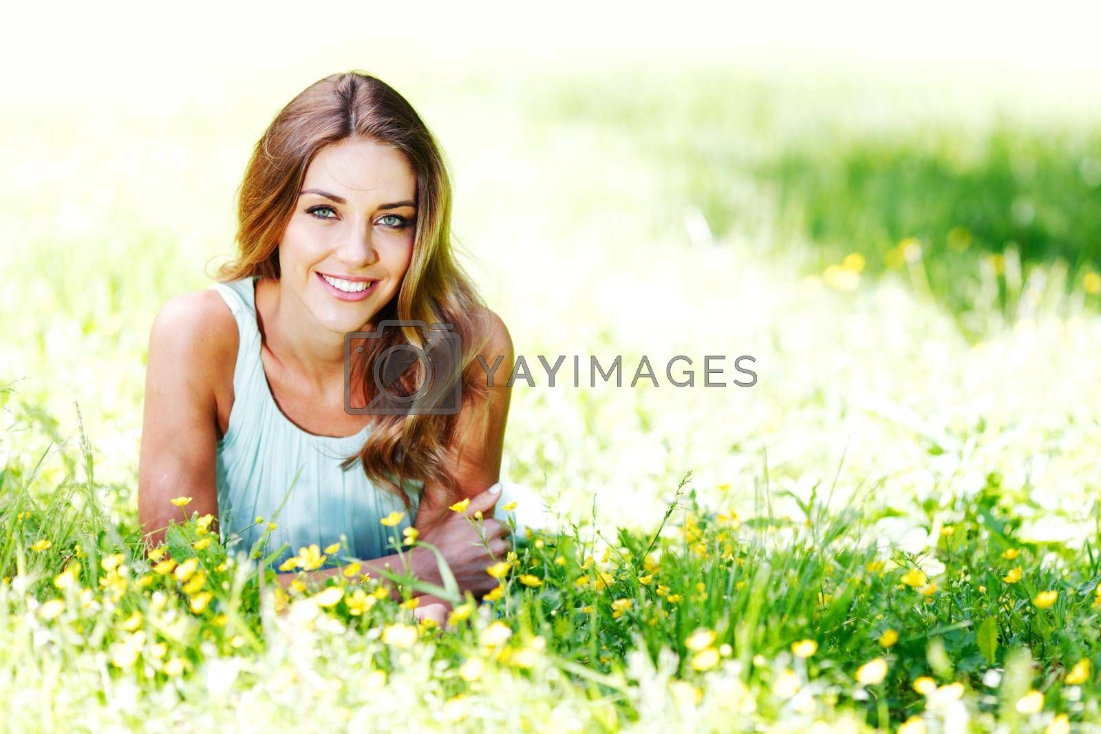 Royalty free image of Woman relaxing on the green grass by Yellowj